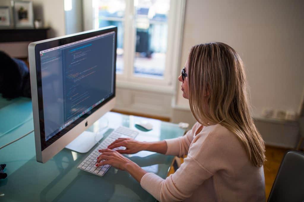 marketing-woman-apple-desk-1024x683
